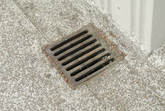 Rusty iron drain cover. Rusty iron square shaped grill covering a drain Royalty Free Stock Photo