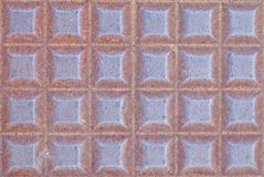 Rusty iron drain cover texture Royalty Free Stock Image