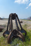 Rusty iron grabber. Left behind rusty iron stone grabber Stock Photography