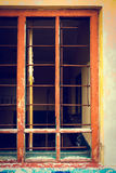 Rusty iron grid instead of window on a grunge background Royalty Free Stock Photo