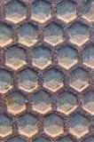 Rusty iron manhole texture close-up Stock Image