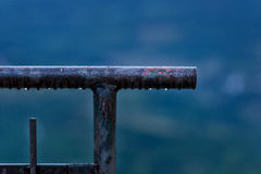 Rusty iron pipe on blue background. stock photo