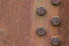 Rusty metal plate texture with bolts. Copy space royalty free stock photography