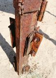 Rusty iron on the sand royalty free stock image