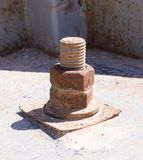 Rusty screw with nut at sunny day. industrial concept Royalty Free Stock Photo