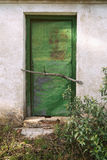 A rusty iron shed or hut painted green in the woods. Stock Photography