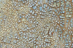 Rusty iron sheet coated with cracked blue paint. Royalty Free Stock Photography