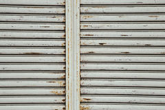 Rusty iron shutter. Gray color rusty iron shutter Royalty Free Stock Photos