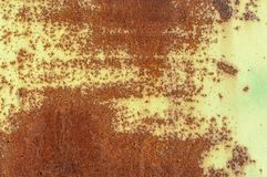Rusty iron surface with green paint remaining royalty free stock photos
