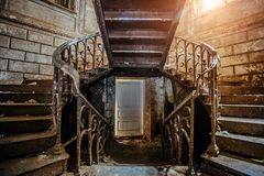 Rusty iron vintage stairs with rivets in the old abandoned mansion. In Polibino, Lipetsk region Royalty Free Stock Photography