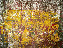 Rusty iron wall covered with paint, abstract texture background. Stock Images