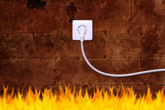 Rusty iron wall with an electrical outlet and fire Royalty Free Stock Photo