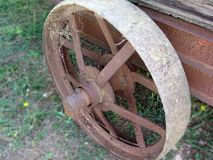Rusty iron wheel of old cart Stock Images