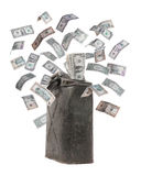 Rusty jerrycan with flying dollar Stock Images