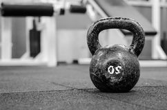 Rusty Kettle Bell on the gym floor Stock Images