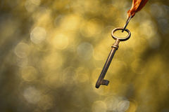 Rusty key in the air Stock Image