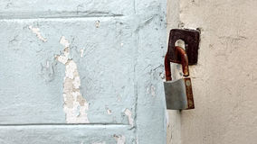 The rusty key lock. The rusty key lock hangs on a gate Stock Image