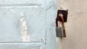 The rusty key lock. The rusty key lock hangs on a gate stock image
