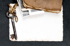 Rusty key, old book and empty photography as a memories  metaphor. Copy space Royalty Free Stock Images