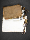 Rusty key, old book and empty photography Stock Image