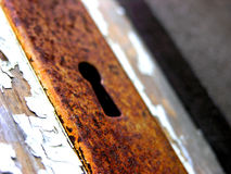 Rusty keyhole. Closeup of an old door panel with a rusty keyhole Stock Photography