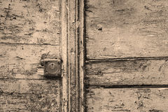Rusty keyhole in a wooden door in black and white Stock Images