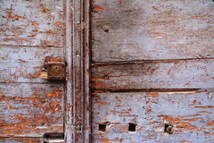 Rusty keyhole in a wooden door Stock Images