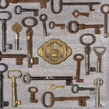 Rusty keys with brass lock on wooden background Stock Photography