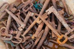 Rusty keys. Many old rusty keys in a bowl close-up Royalty Free Stock Photos