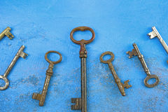Rusty keys. Old keys on blue background in front Royalty Free Stock Images