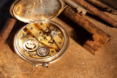 Rusty keys and pocket watch Stock Image