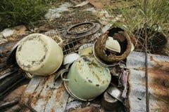 Rusty Kitchen Scrap Metal. Kitchen scrap metal lying on top of rusty zinc roofing Stock Photography