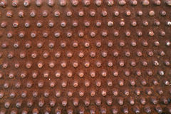 Rusty knobs!. Rusty knobs or prongs from some old machinery. Ideal background image royalty free stock photo