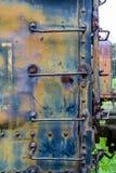Rusty Ladder en el coche de tren azul foto de archivo