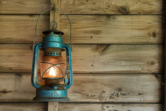 Rusty lantern hanging in a shed Stock Images