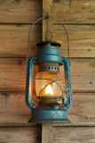 Rusty lantern hanging in a shed Stock Image