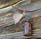 Rusty lantern hanging at a wooden wall Stock Photos