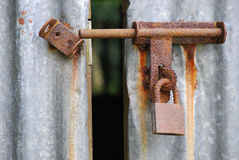 Rusty Latch And Lock. A photo taken on a rusty bolt, latch and lock on a barn door Royalty Free Stock Photo