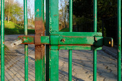 Rusty latch in the metal gate Royalty Free Stock Image