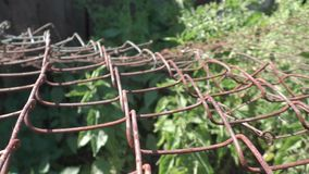 Rusty lattice - wooden and metal fence stock video
