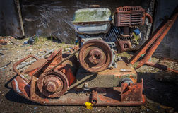 Rusty lawn mower. Abandoned rusty lawn mower,Rusty retro agricultural machinery Stock Image
