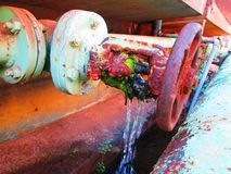Rusty and leaking green pipe valve to be replaced Stock Photo