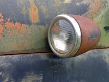 Rusty Light. Detail of a turn signal on a rusty old Dodge truck stock image