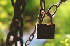 Rusty lock and chain Stock Photos