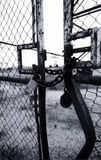 Rusty lock and chain on old bent gate Royalty Free Stock Photo