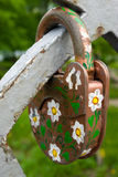 Rusty lock covered with camomile drawings. At a bridge fence - a symbol of reliable marriage Stock Images
