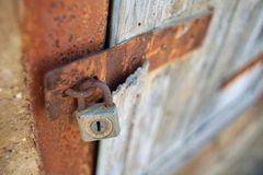 Rusty lock. A detail of a rusty lock on a rusty door Royalty Free Stock Images