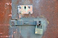 Rusty lock on garage gate Royalty Free Stock Photos