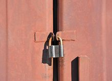 Rusty lock on garage gate Royalty Free Stock Images