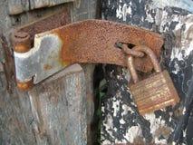 Rusty Lock and Hinge. On peeling door stock photo